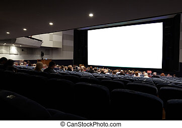 Cinema auditorium with people.