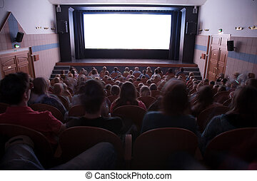 Cinema auditorium with people in chairs watching movie ...