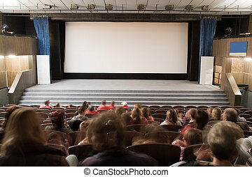 People in cinema auditorium with line of violet chairs and silver screen are waiting for movie performance. Ready for adding your own picture.