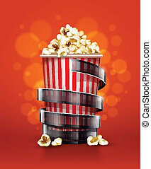 cinema concept with paper bucket with popcorn and film tape