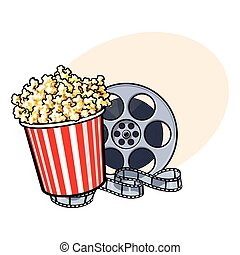 Cinema objects - popcorn bucket and retro style film reel