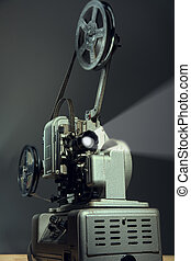 Cinema projector with a film on dark background