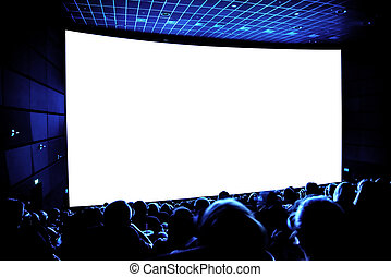 Cinema. The audience in 3D glasses watching a movie. A white...