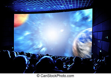 Cinema. The audience in 3D glasses watching a movie....