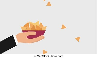 cinema theater related - hand holding bowl with nachos snack