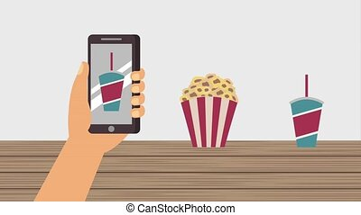cinema theater related - hand holding smartphone ordering...