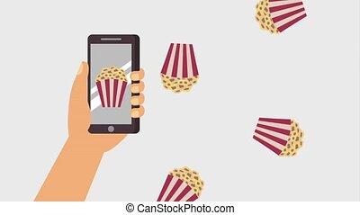 cinema theater related - hand holding smartphone popcorn...