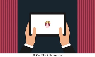cinema theater related - hand holding tablet ordering...