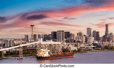 Cinemagraph Continuous Loop Animation. Downtown Seattle, Washington, United States of America. Aerial Panoramic View of the Modern City on the Pacific Ocean Coast. Dramatic Sunset Sky Art Render.
