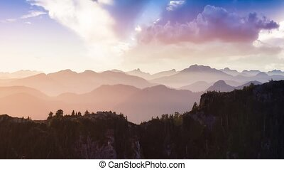Cinemagraph Continuous Loop Animation of Aerial view from above of Rocky Mountains. Canadian Nature Background. Located near Squamish and Vancouver, British Columbia, Canada. Sunset Sky