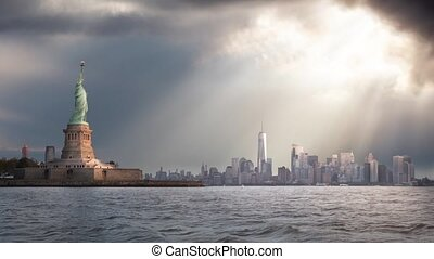 Cinemagraph Continuous Loop Animation. Panoramic view of the Statue of Liberty and Downtown Manhattan in the background during a vibrant cloudy sunrise. Taken in New York City, NY, United States.