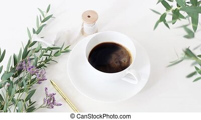 Cinemagraph. Cup of coffee, wedding bouquet, silk ribbon and...