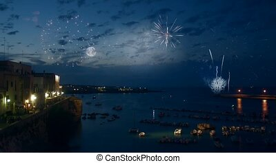 Cinemagraph. Fireworks and night view of seaport at Otranto, southern Italy