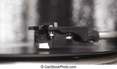 vinyl record spinning. Wide shot close up of needle playing record album on a vintage turntable. Old school record player