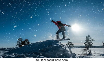 Cinemagraph. Novice snowboarder in a jump with a light snow...