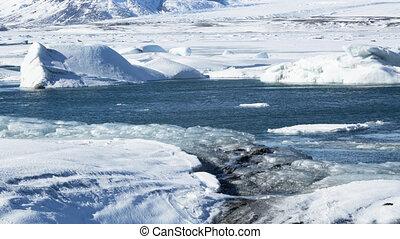 Cinemagraph of ice blocks at glacier lagoon Jokulsarlon,...