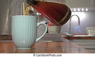 Cinemagraph of making coffe the conventional way.