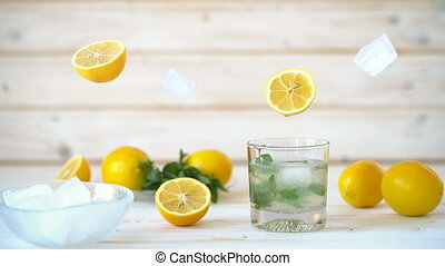 Cinemagraph - Pouring the lemon juice into a glass with ice and mint