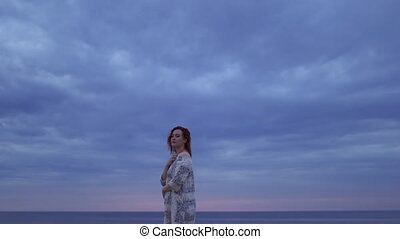 Cinematic background: Young woman girl in a white dress...