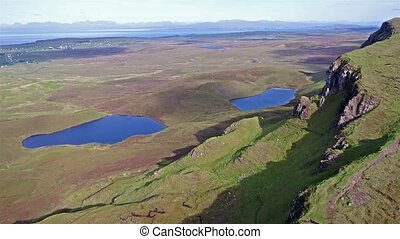 Cinematic flight over the Quiraing on the eastern face of...