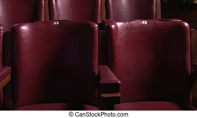 Cinematic shot of cinema chairs - A scenic gliding shot of...