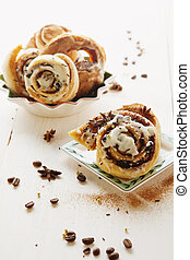 Cinnabons with raisins, cinnamon and vanilla sauce