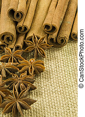 Cinnamon and Star Anise on hessian background