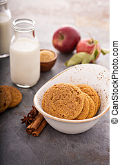 Cinnamon applesauce cookies with spices and milk bottle