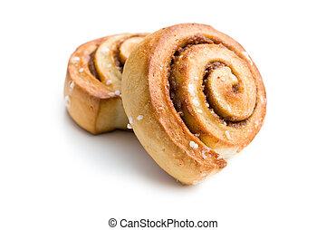 cinnamon buns on white background