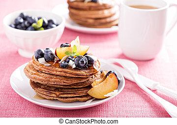 Cinnamon coconut flour pancakes with fresh fruits