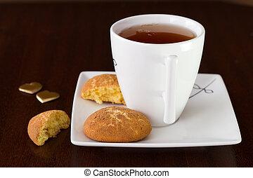 cinnamon cookies with cup of tea