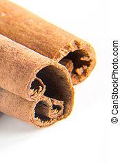 Cinnamon macro - Cinnamon sticks macro on the white...