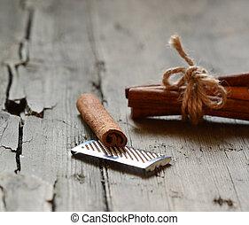 Cinnamon on wooden background