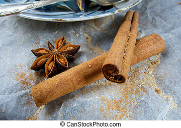 Cinnamon pieces and cup of tea
