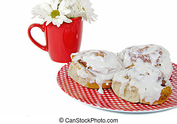 cinnamon rolls on gingham plate