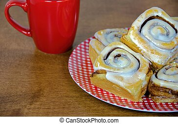 cinnamon rolls on gingham plate