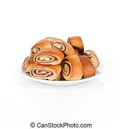Cinnamon rolls on plate.