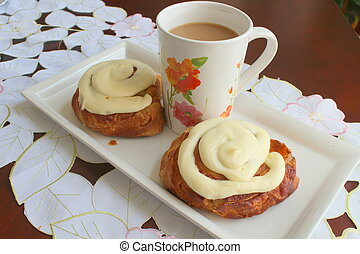 Cinnamon rolls with a cup of coffee