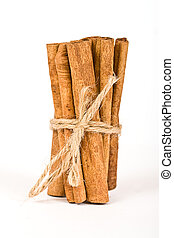 cinnamon spicy sticks close-up isolated over a white 