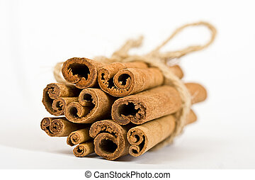 cinnamon spicy sticks close-up isolated over a white...