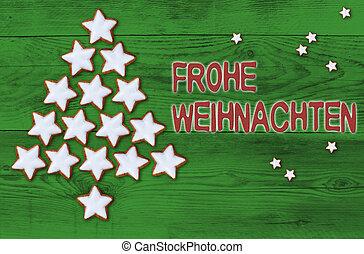 Cinnamon stars Christmas tree Frohe Weihnachten (in german Merry Christmas) concept