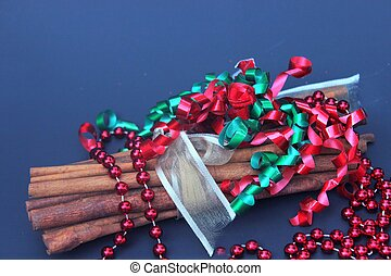 Cinnamon stcks with red beads for Chrstmas
