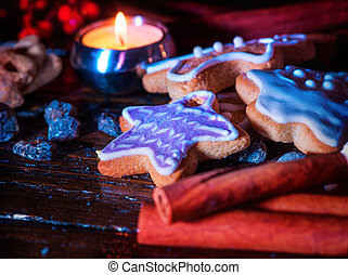 Cinnamon stick background with Christmas gingerbread man on wooden table