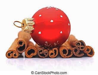 cinnamon sticks and christmas ball