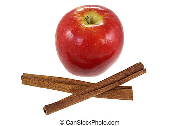 Cinnamon sticks and fresh Red Apple, isolated on white...