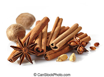 Cinnamon sticks and spices on white background