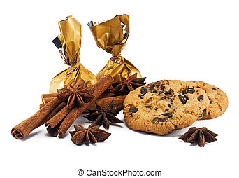 Cinnamon sticks, anise stars, candy and chocolate chips cookies