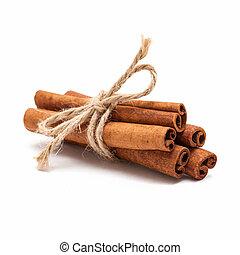 Cinnamon sticks - Five cinnamon sticks tied by rope isolated...
