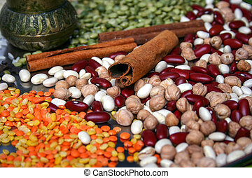 Cinnamon sticks, green peas, spices, lentils, legumes on plate. Close up