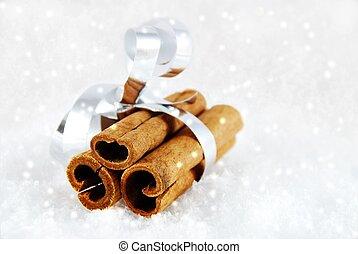 cinnamon sticks in the snow